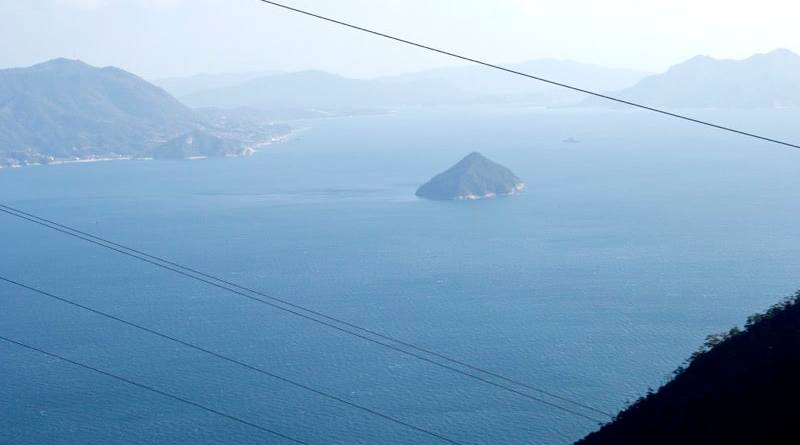 View of a small uninhabited island in the seto inland sea seen from the summit of Mt. Misen on Miyajima in Hiroshima, Japan
