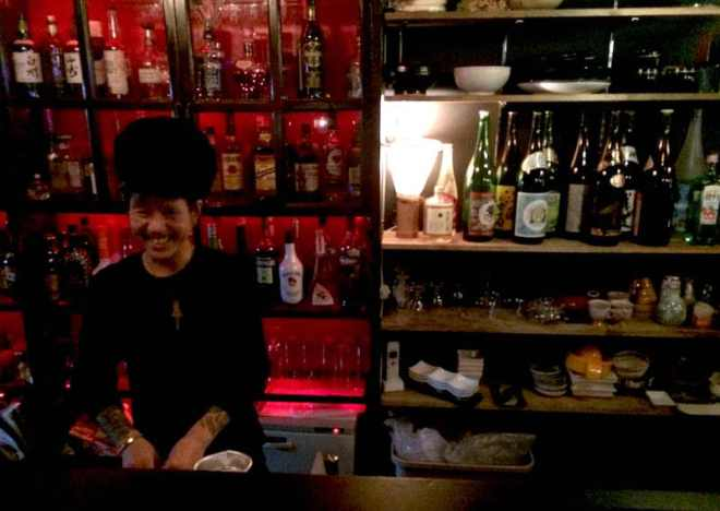 Negoro behind the bar at HUG in Hiroshima