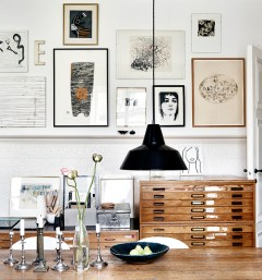 Thick black frames accent a black and white color palette.