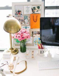 A sleek modern desk with an antique lamp.