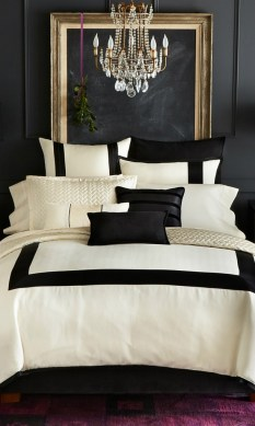 Make a black wall work with natural light and bright bedding.
