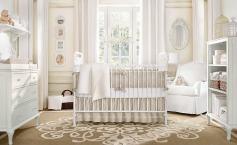 A cream white baby nursery with romantic shabby chic décor.