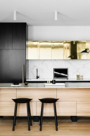 A sleek countertop compliments these bold kitchen colors.