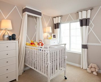 A neutral color palette creates a soft and soothing nursery.