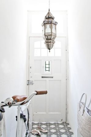A metallic Moroccan chandelier adds the perfect balance between ordinary and unusual.