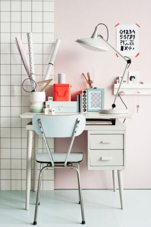 An oversized lamp paired with a vivacious pastel office.