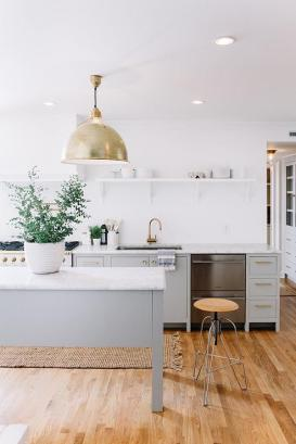 Add some polish into a modern kitchen by placing metallic accent lights that reflect shine.