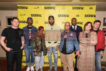 """AUSTIN, TX - MARCH 17: Netflix executive Ben Cotner, director Sacha Jenkins, Rapsody, Dave East, T.I., director Marcus A. Clarke, Netflix executive Zana Lawrence and producer Peter Bittenbender attend the red carpet premiere of """"Rapture"""" during SXSW 2018 at Paramount Theatre on March 17, 2018 in Austin, Texas. (Photo by Daniel Boczarski/Getty Images for Netflix) *** Local Caption *** Ben Cotner;Sacha Jenkins;Rapsody;Dave East;T.I.;Marcus A. Clarke;Zana Lawrence;Peter Bittenbender"""