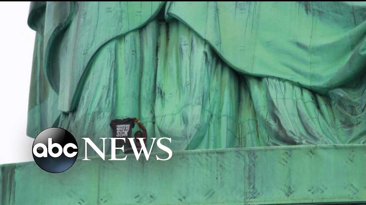 Island is evacuated after woman climbs Statue of Liberty