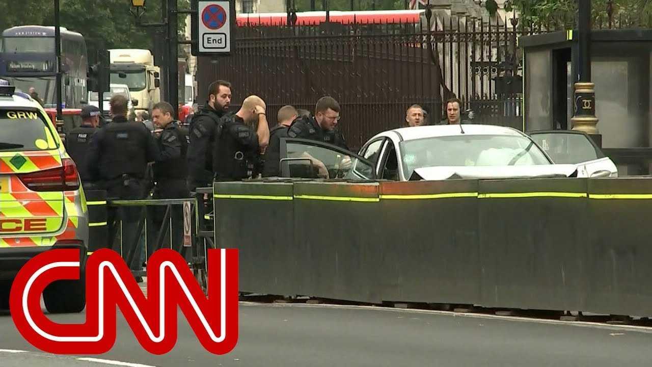 Car crashes into barrier outside UK parliament, man arrested