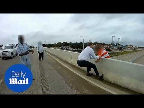 Texas police and bystanders rescue man prepared to jump off overpass - Daily Mail