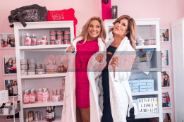 Gina Kirschenheiter and Emily Simpson show off Beauty Kitchen's monthly subscription beauty box while at Beauty Kitchen Boutique's grand opening.