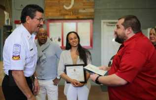Chief Randy Crider congratulates Chris Hayes-Optimized