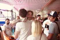 Post Malone embraces a fan before his headlining performance on Day 2