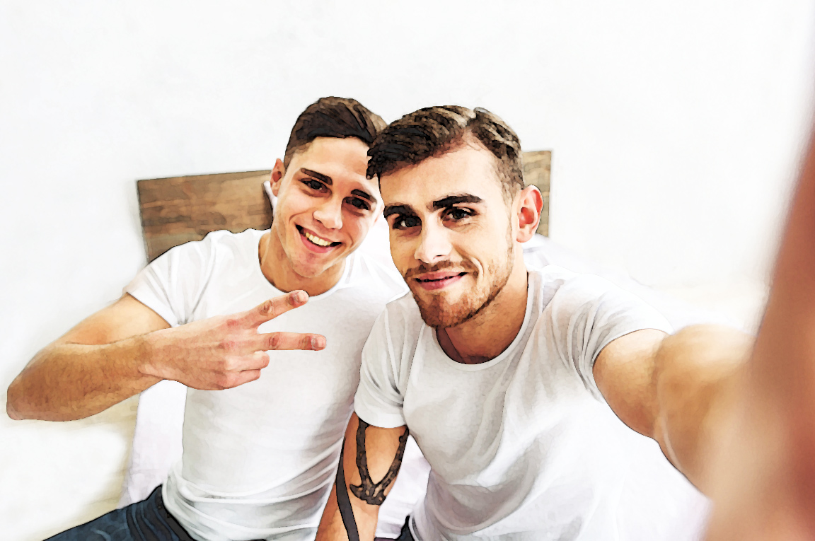 men smiling at the camera