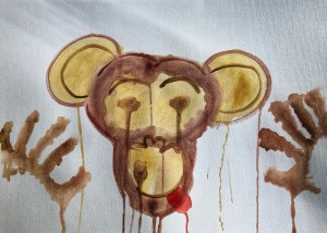 Painting of a monkey sticking out it's tongue.