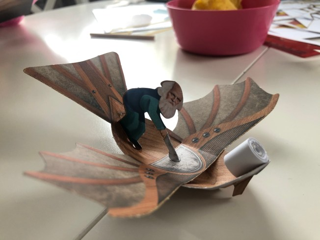 Small flying paper model of one of da Vinci's drawings.