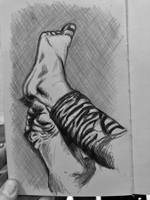 Drawing of feet stretched out on the floor.