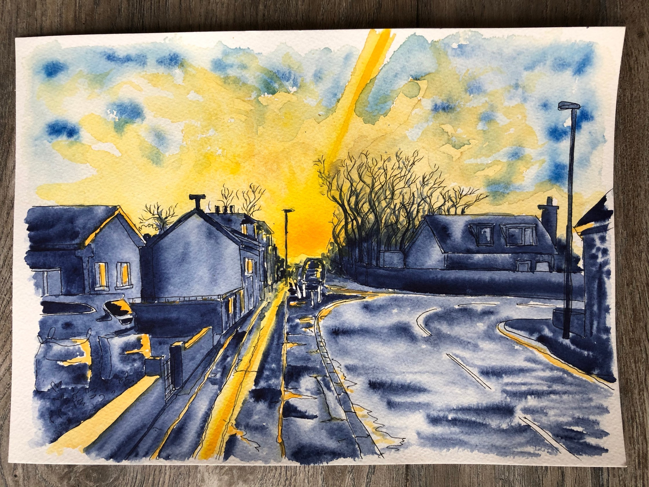 Watercolor painting of Main St in Chryston Scotland in blue and yellow.