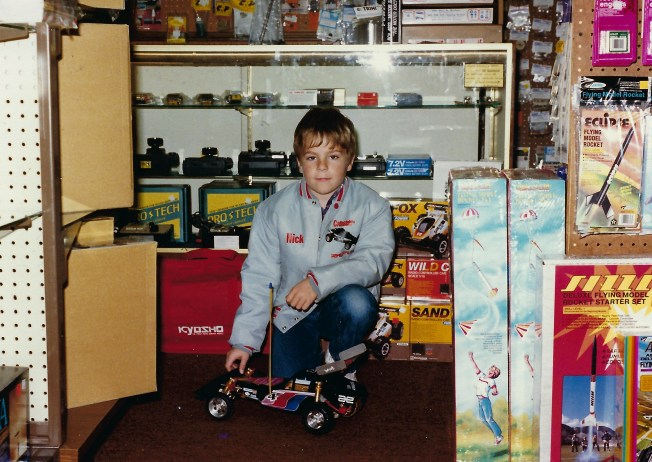 Me as a child at my Dad's store with my store jacket on.