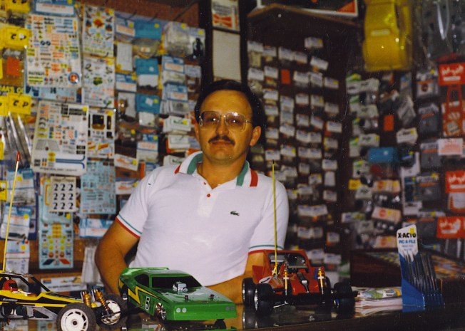 My Dad at the counter of his store.