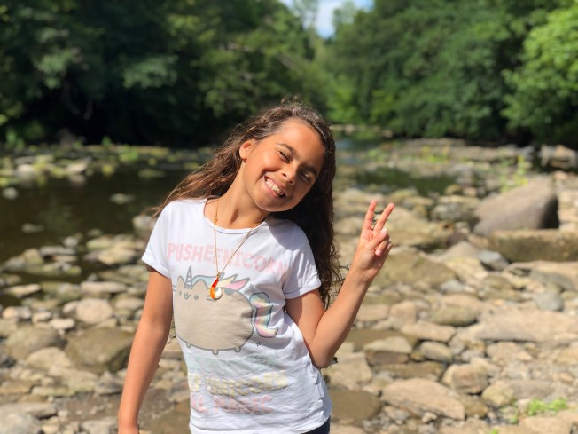 Portrait of Vivian giving a peace sign.