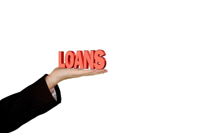 hand holding a loan sign