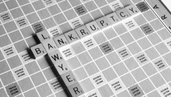 Bankruptcy spelled in scrabble