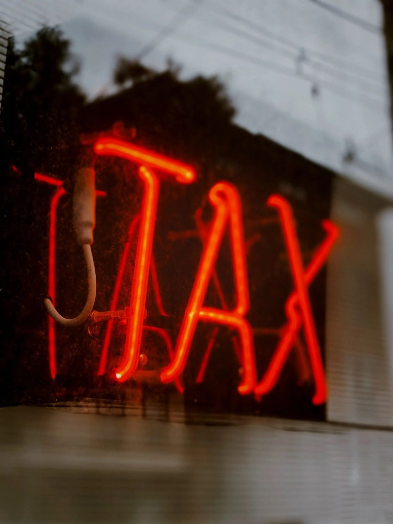 neon tax sign