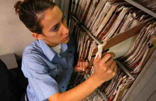 US Navy 041019 N 5821P 019 Airman Lauren Thurgood of Las Vegas2C Nev.2C pulls patient medical records in the inpatient ward aboard the conventionally powered aircraft carrier USS Kitty Hawk - Healthcare Data - Who's Responsibility is it?