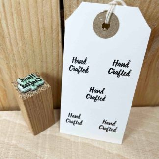 """mini rubber stamp that reads """"hand crafted"""" in a cursive font"""