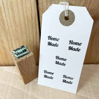 small rubber stamp made from green rubber and oak that reads 'home made'