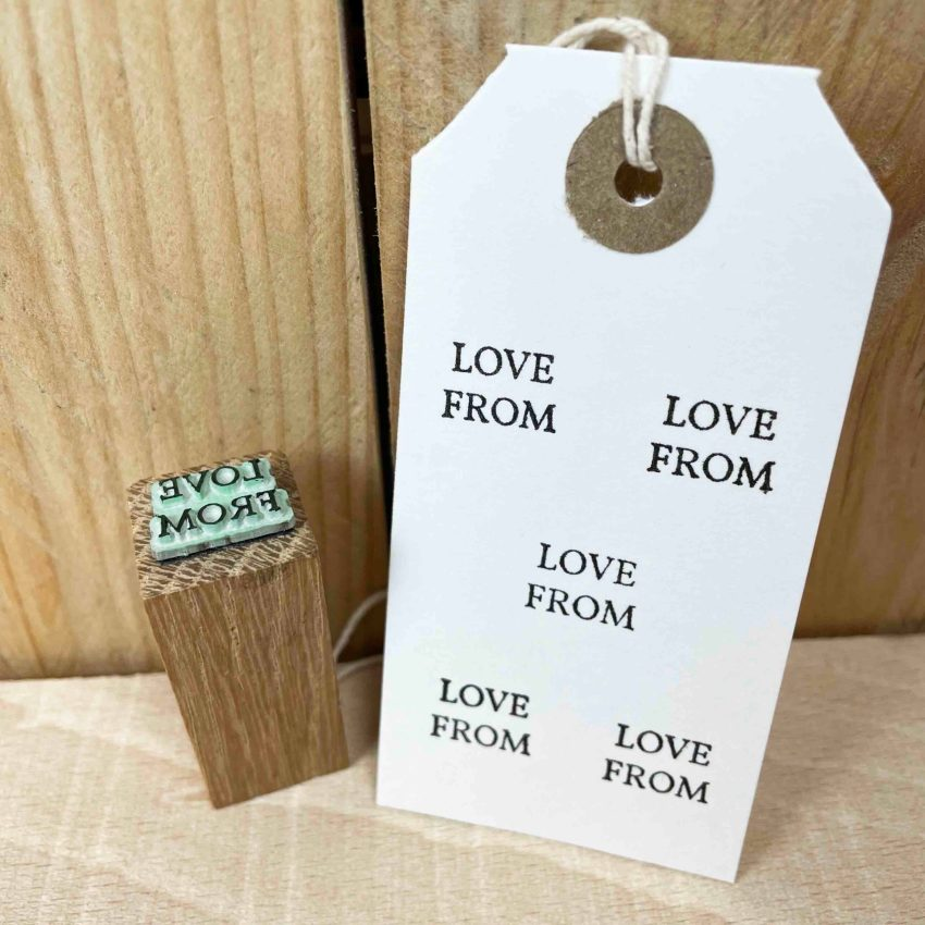 small rubber stamp that reads 'love from'
