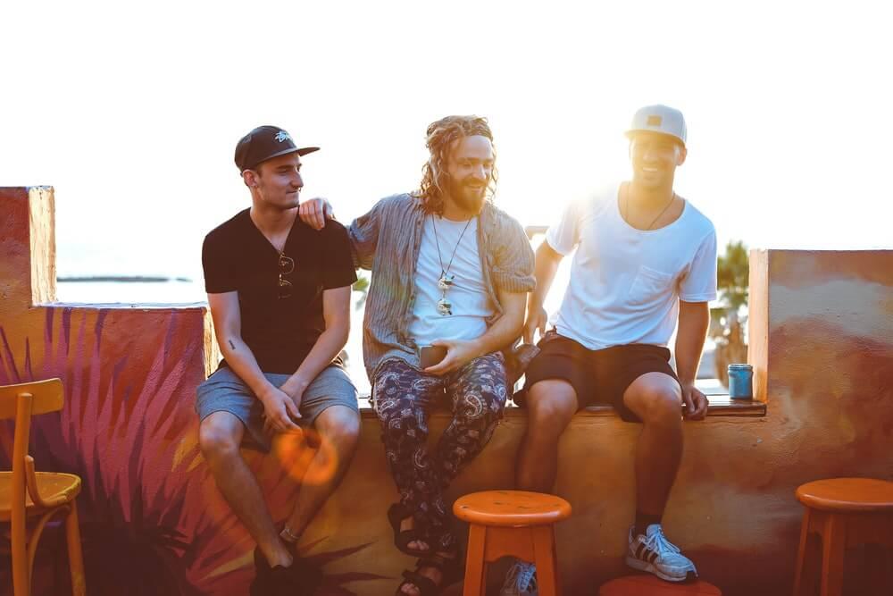 Three Men Sitting On Veranda 1194412 (1)
