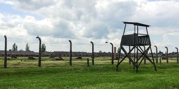 The camp buildings, fences and guard houses remain