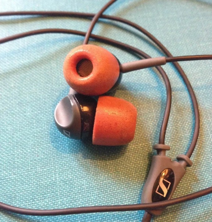 Headphones with red tips.