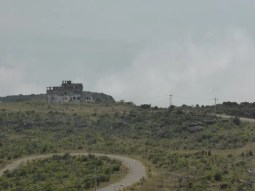 Bokor Palace hotel from afar, clouds approaching