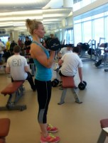 Keeping your elbows in, touching your sides, begin to curl the dumbbells up towards your shoulders.