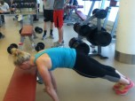 This is akward...bad angle but...step both hands down so you are now in a plank on the floor.