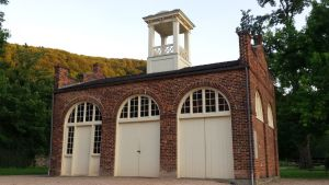 During the raid in October 1859, John Brown, some of his men, and about forty hostages were barricaded in this engine house, which belonged to the Federal Armory and Arsenal. This building is used by Harpers Ferry NHS to interpret and represent the raid itself and the struggle for freedom that continued long after the end of the war. The fort was moved four times before finally returning to its current location in Harpers Ferry in 1968. The fort was first removed from its original location in 1891 to be displayed at the World's Columbian Exposition in Chicago, then it was placed at the Murphy Farm about three miles outside of Harpers Ferry in 1895. On this farm in July 1896, the first National Convention of the National League of Colored Women and in August 1906, the second Niagara Conference, the forerunner to the NAACP, visited the Fort. To them, John Brown's Fort symbolized the continuing struggle for African American freedom and equality. In 1909, Storer College, a local school that was established to educate African Americans and anyone else despite race and gender, acquired the building and placed it on campus. Finally, the Fort returned to Harpers Ferry in 1968 when the National Park Service acquired it. It now stands about 150 feet from its original location. Photo credit Alexandria Andrioli.