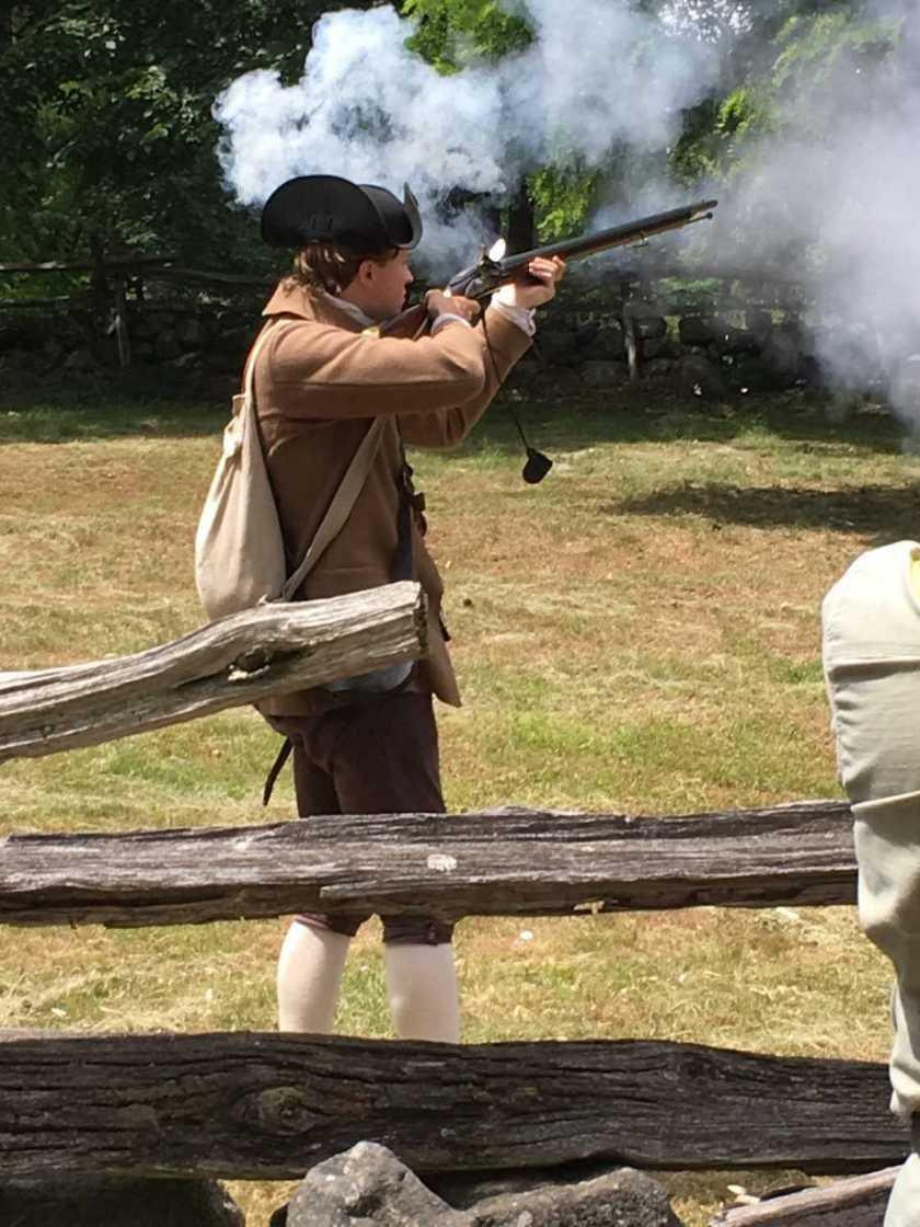 Roy firing a musket