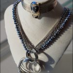 Long silver colour multistrand Necklace with Hoops