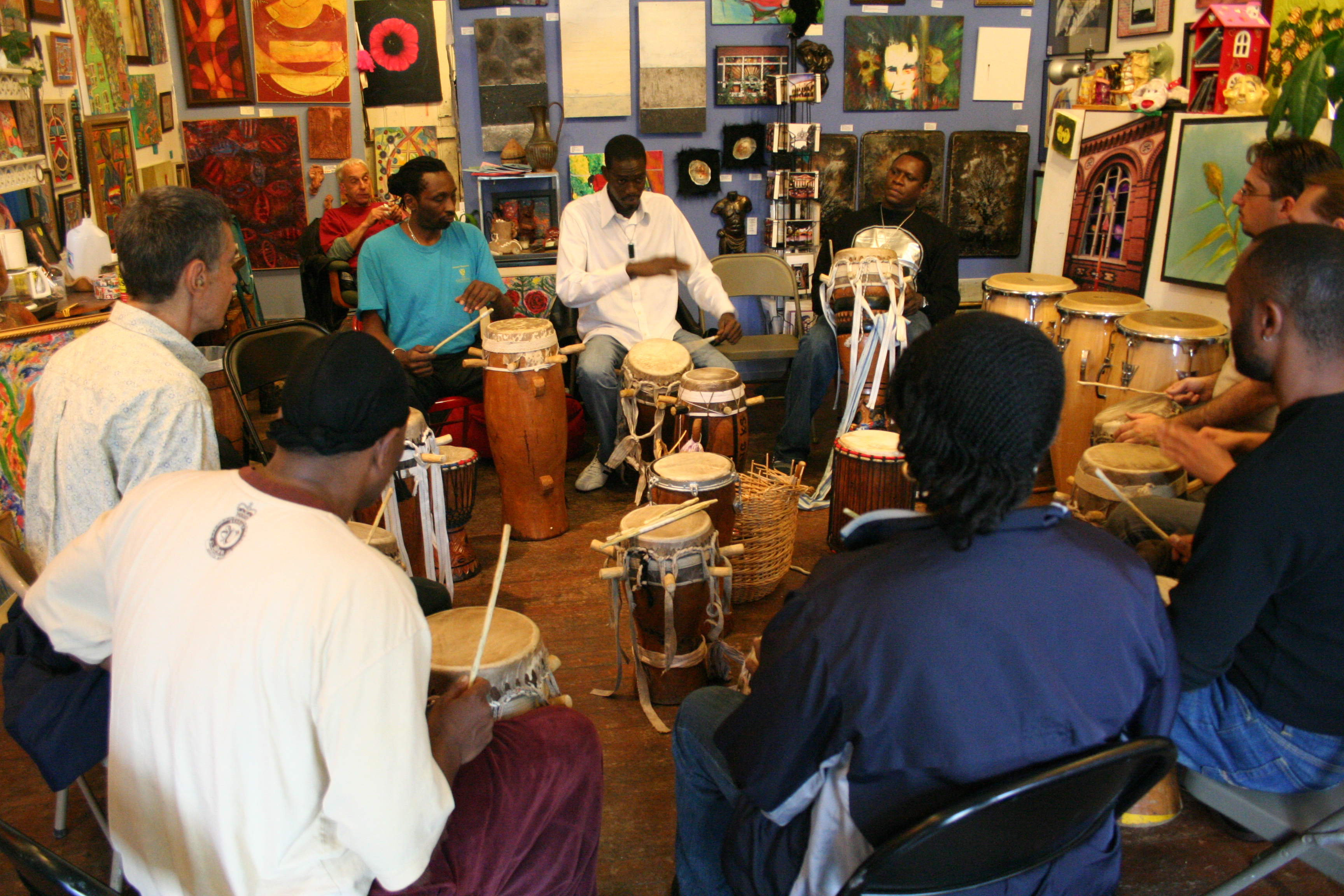 Molustapha Faye teaches a drum class