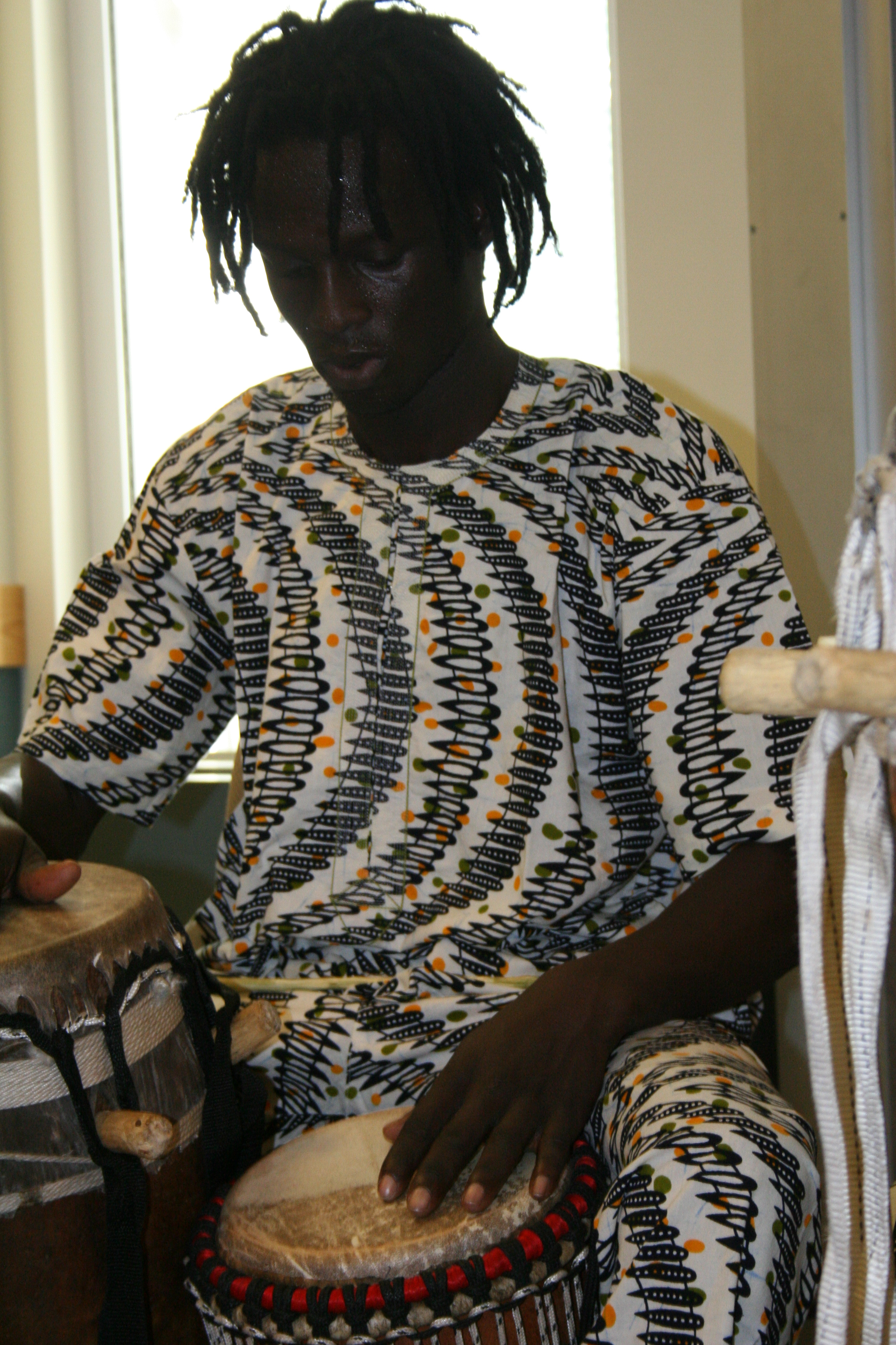 Malick Ngom plays sabar.