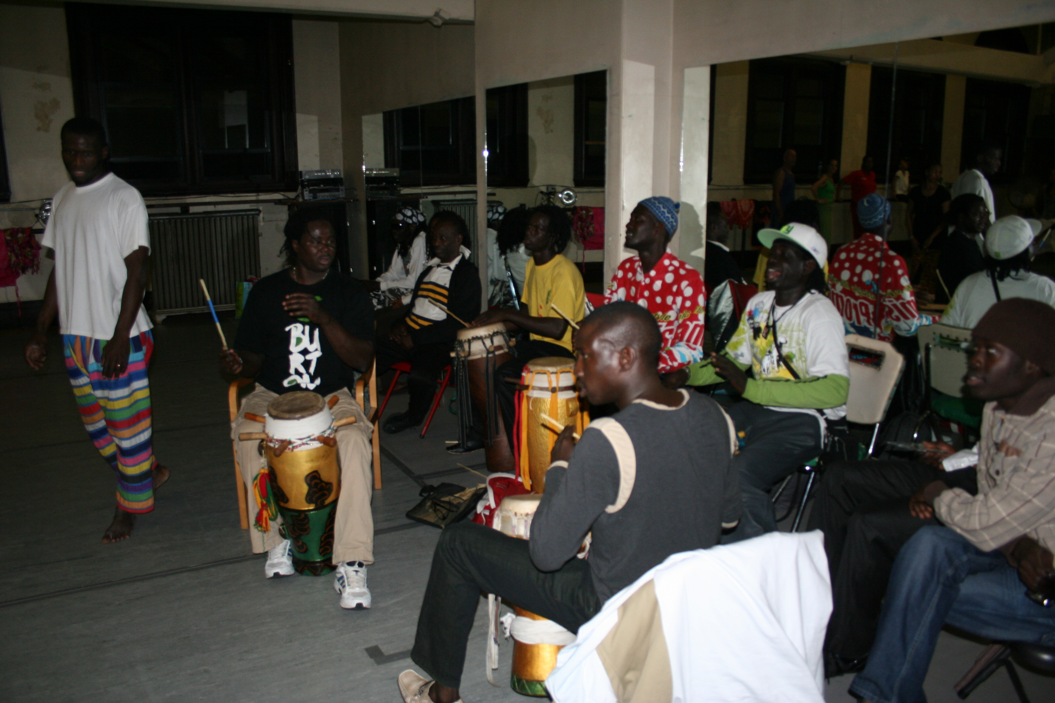 Playing class with Pape Ba (left) and Thiokho Diagne (seated).