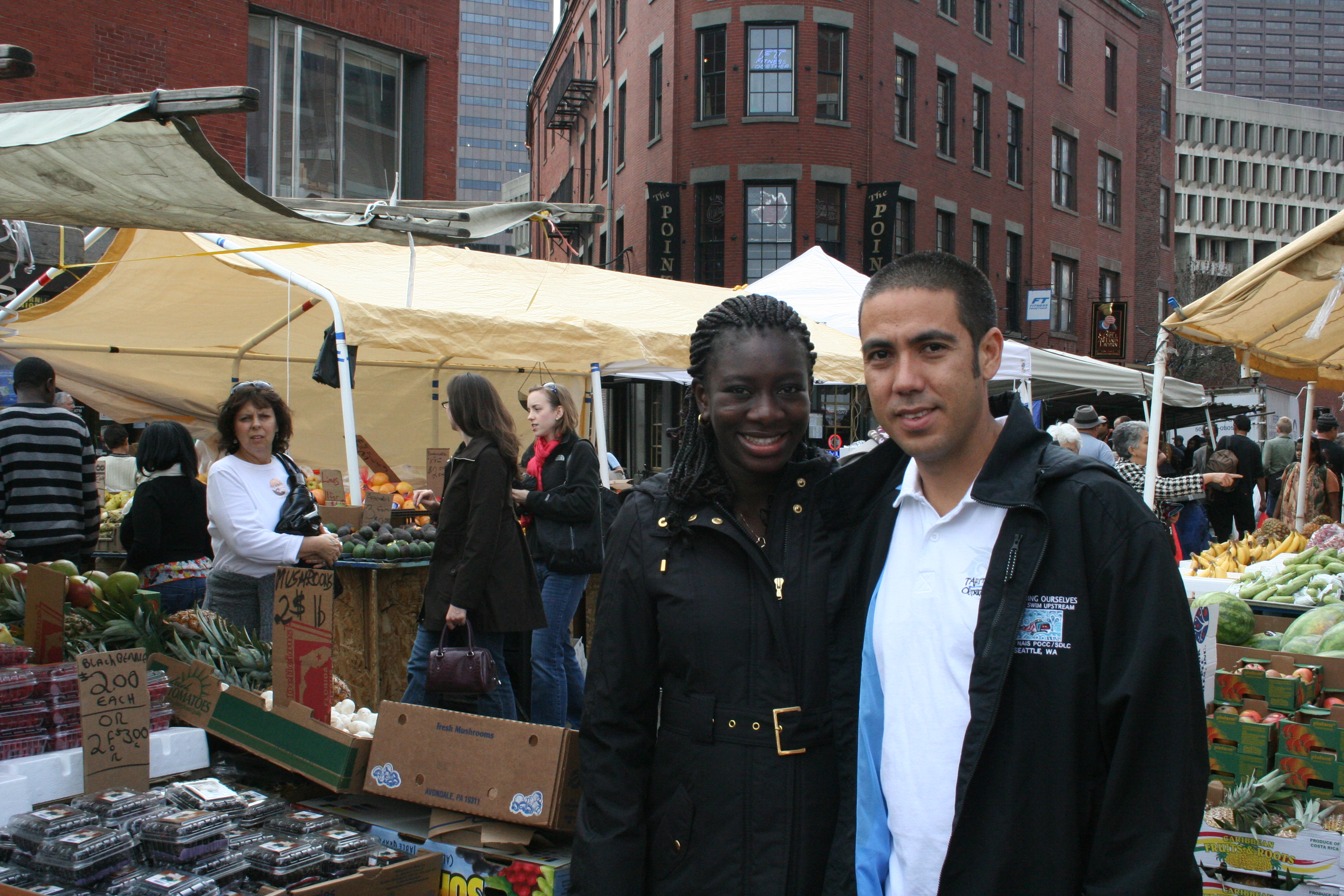 Kapono and Ndey Ngom Faye at historic Haymarket in Boston.
