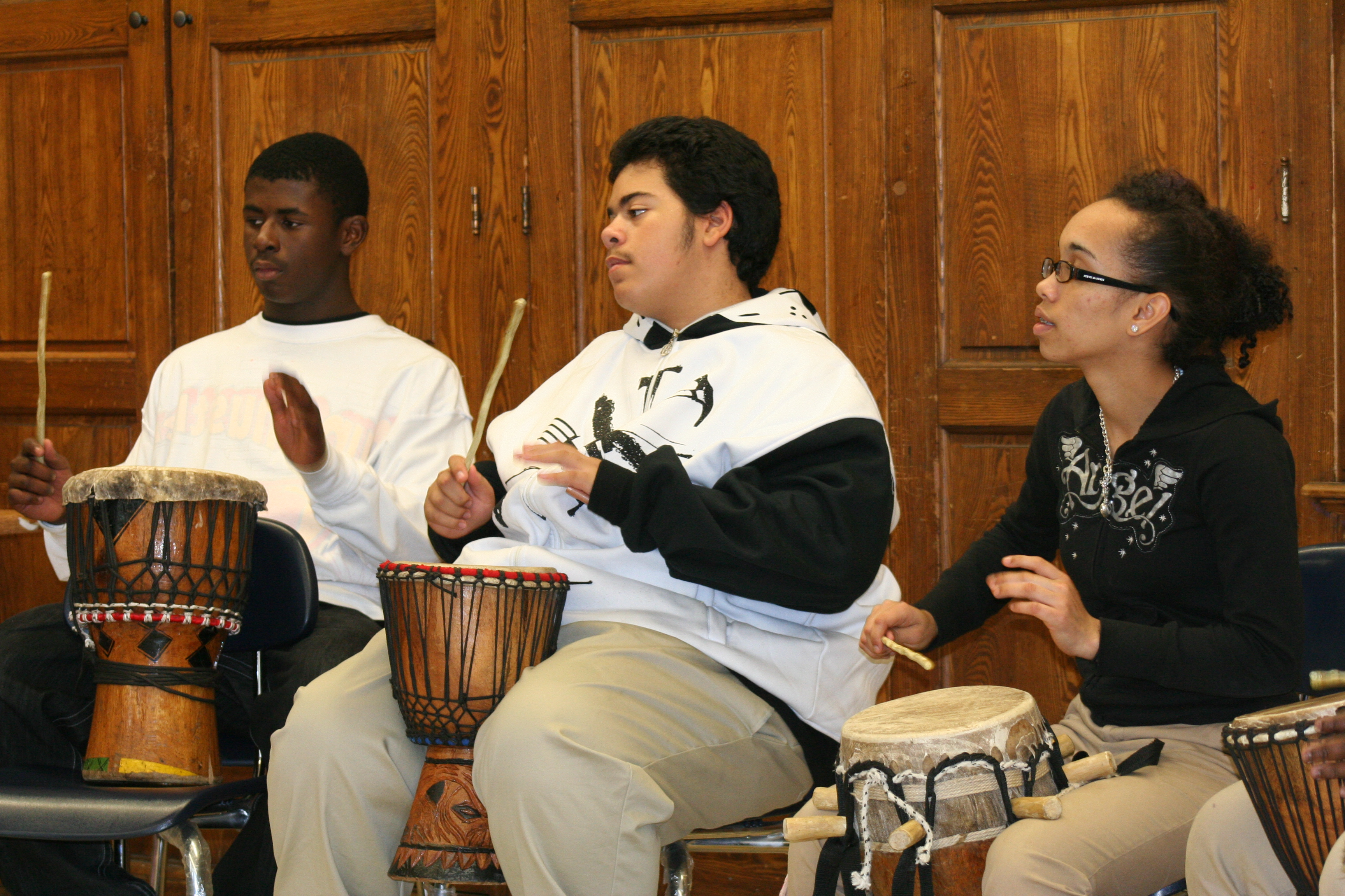 Students at Young Achievers playing a sabar rhythm.