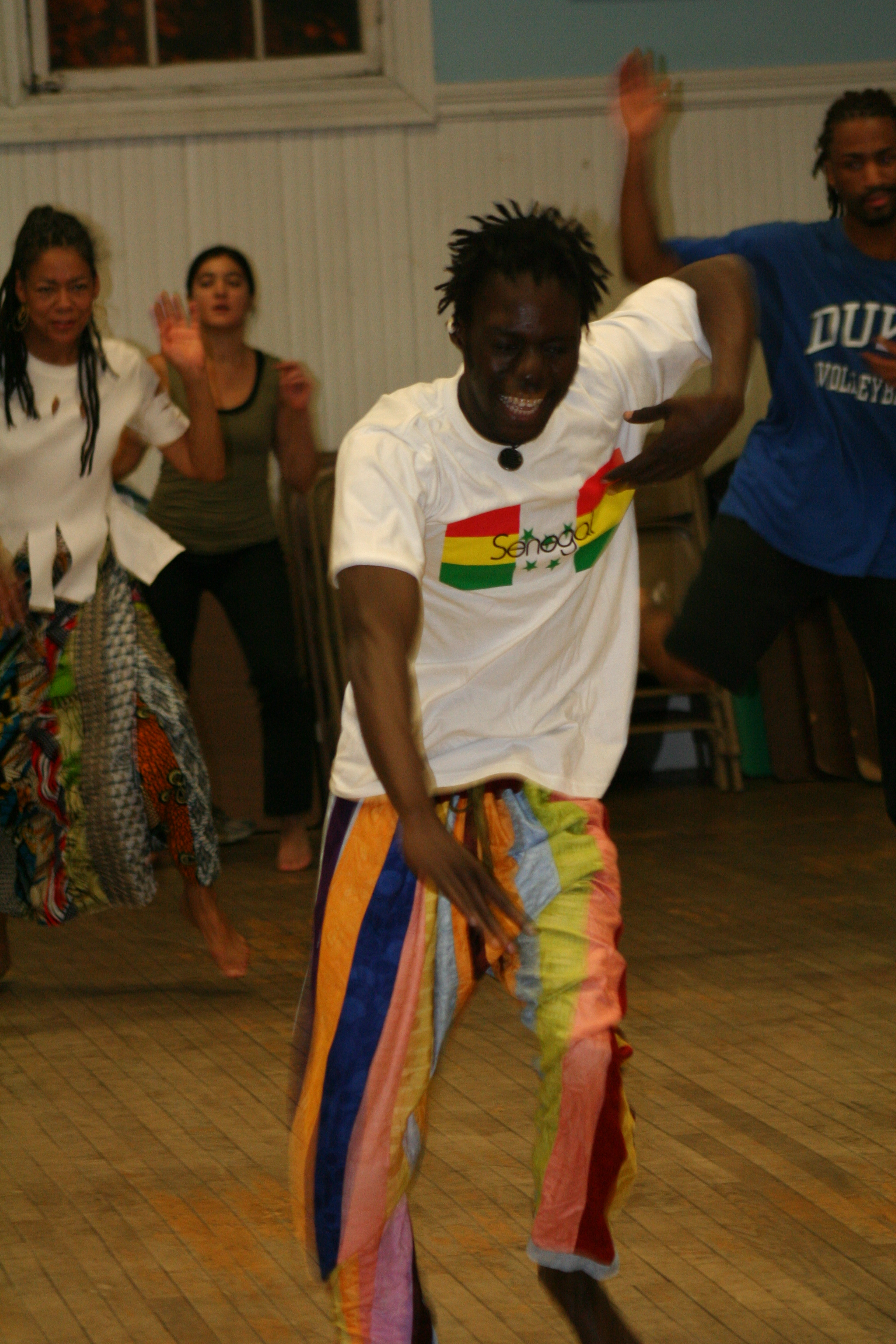 Pa Seck teaching dance class.
