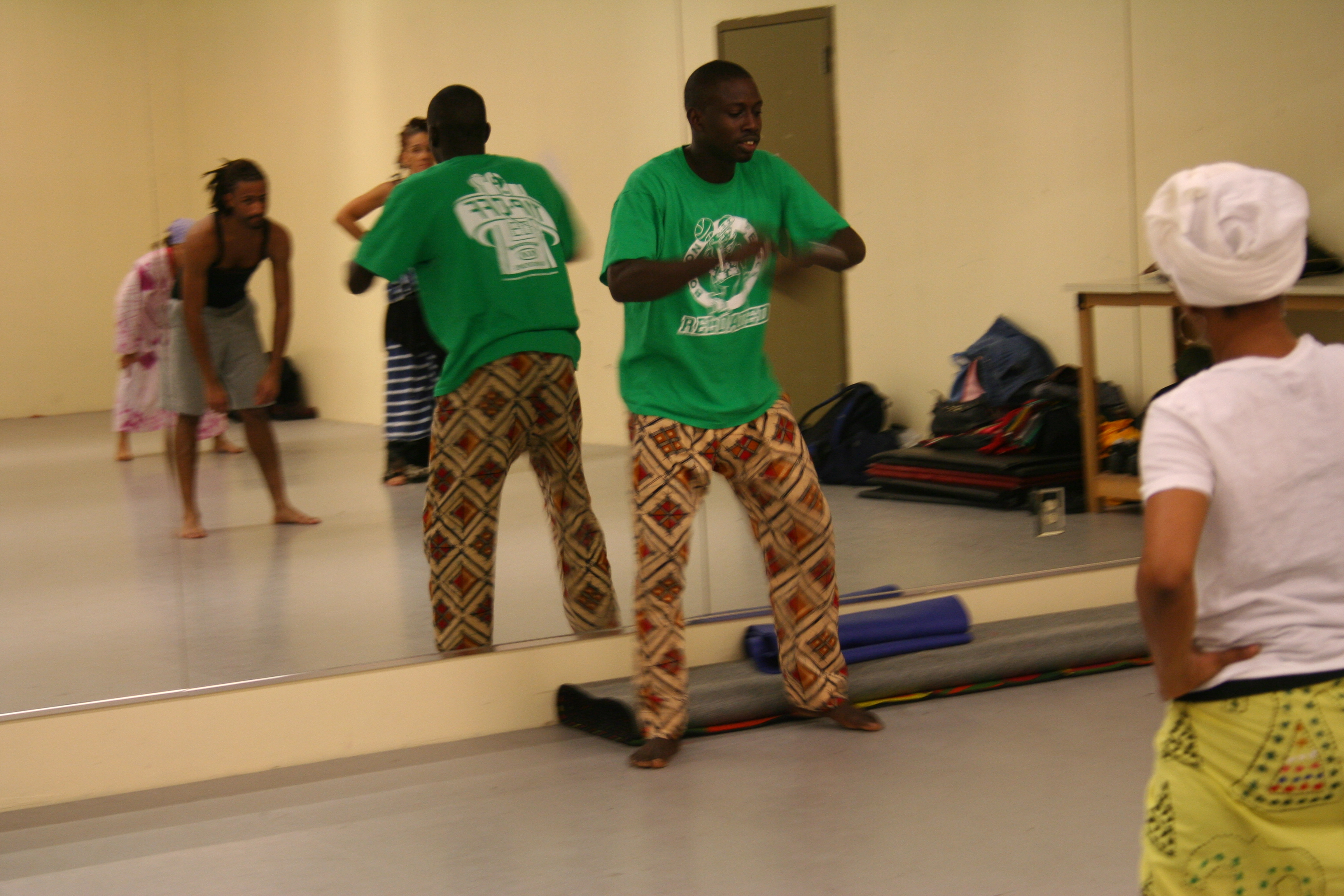Aziz Faye instructing dance class.