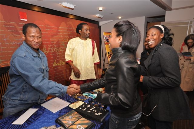 Lamine Diallo greets students at Sing Sing Tradition concert.